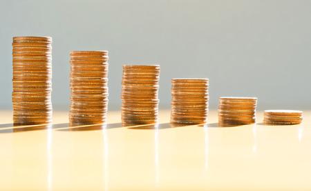 dedo: Gr�fico de las monedas Foto de archivo