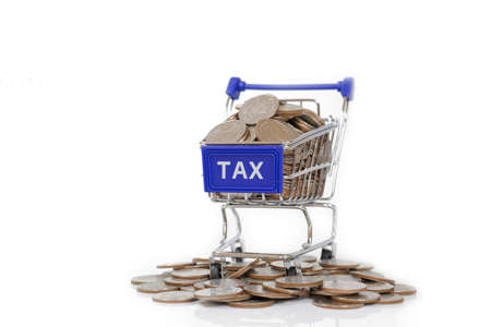 tax tips: TAX concept with shopping cart with full of coin. Stock Photo
