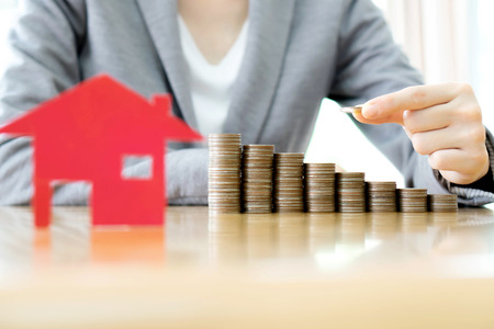 real estate investment: Real estate investment. House and coins on table. Stock Photo