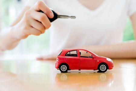 car leasing: small car and key for car, car leasing and car loan concept
