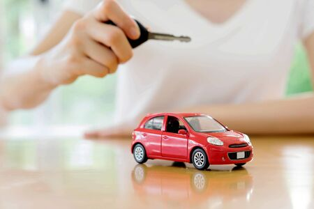 car loan: small car and key for car, car leasing and car loan concept