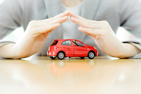 solicitude: Businesswoman hands and car as protection of car concept Stock Photo