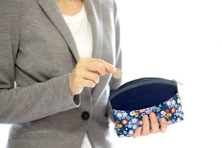 depreciation: Businesswomen hands holding british coin and small money pouch
