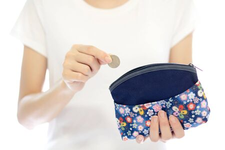 destitution: Hands holding british coin and small money pouch Stock Photo