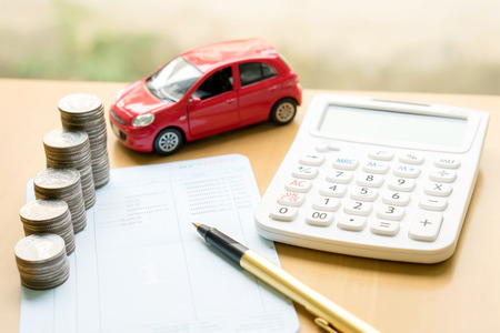 Coins stack in columns on saving book and car on finance concept Imagens - 69838374