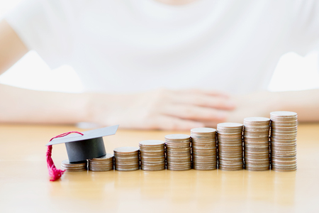 Women saving education coins