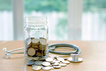 Education budget concept. stethoscopes money savings in a glass