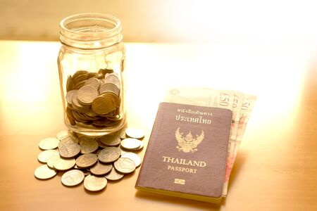 Savings jar with currency for travel