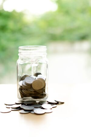 single word: Coins Into Glass Jar