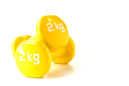 Yellow dumbbell weights