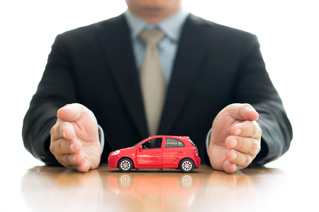 Businessman hold a car Stock Photo