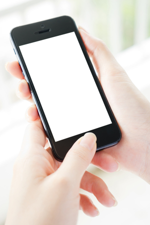 Woman typing on mobile phone isolated white screen