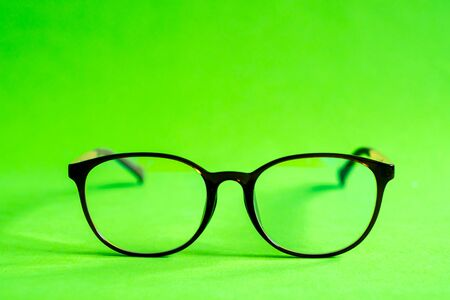 Glasses on a green background