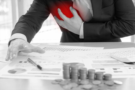Businessman clutching his chest from acute pain. Heart attack symptom-Healthcare and medical concept Stock Photo