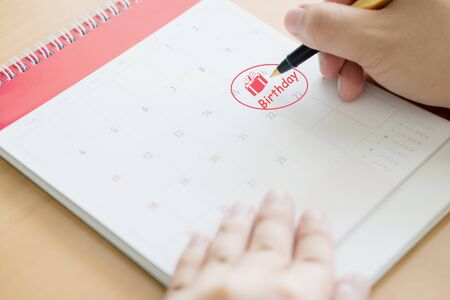Hand writing in calendar plan and coins concept, Gift