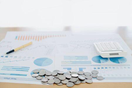 Graphs Calculator and Pen. Finance Concept