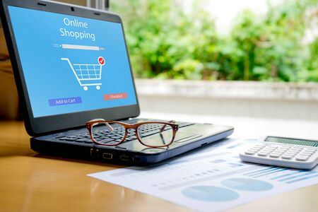Glasses on laptop Shopping online
