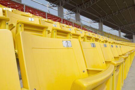 Bright yellow and red stadium seats on the stadium sport
