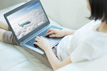 Flight search on internet, buy ticket online 免版税图像
