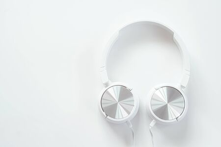White earphones on white background isolate 版權商用圖片