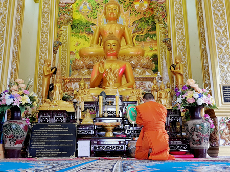 Bangkok, Thailand - 2018 Jun 16 :  Monks praying at Wat Thai, Thailand