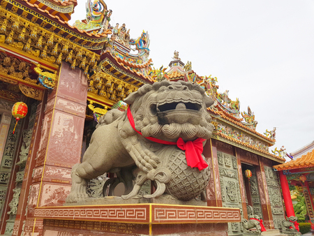 Lion marble head in front of an ancient architecture in chinese temple