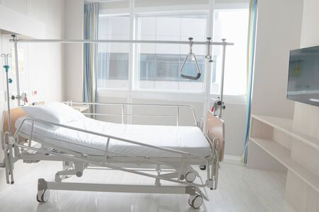 Soft focus background of electrical adjustable patient bed in hospital room