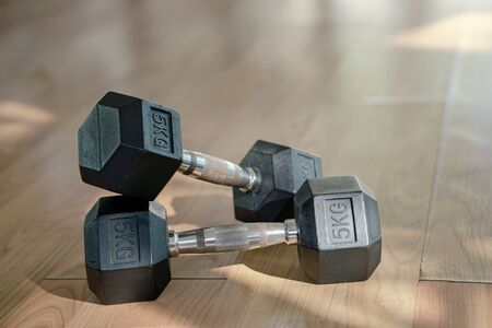Dumbbells on parquet floor Exercise Room