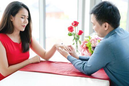 Man proposing engagement ringto his girlfriend