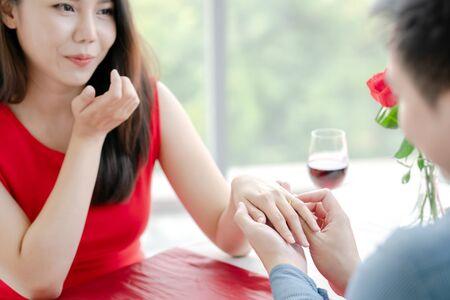 Man proposing engagement ringto his girlfriend Stock fotó