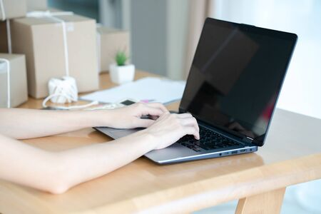 Asian women working laptop computer selling online start up small business owner.