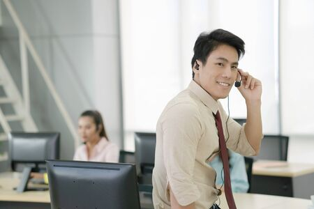Asia call center workers or Confident business with headset,Customer support standing