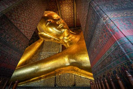 Reclining Buddha gold statue. Wat Pho, Bangkok, Thailand, travel landmark.
