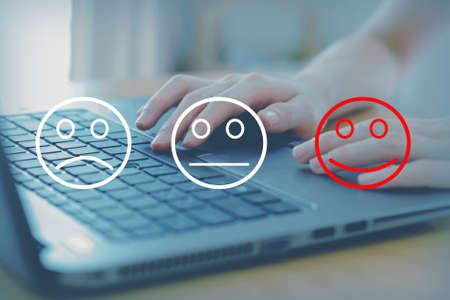 Woman select happy on satisfaction evaluation on laptop, concept.