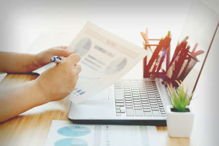 Businessman analyzing investment marketing charts with laptop, business concept