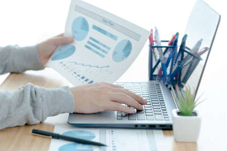 Businessman analyzing investment marketing charts with laptop. Business concept