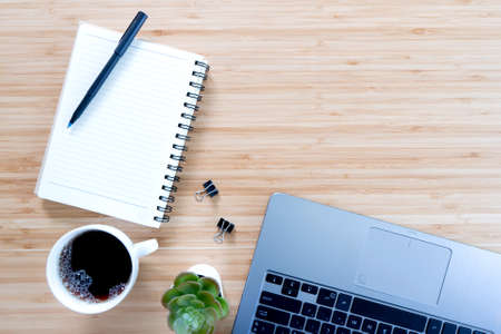 flat lay composition with notebook, pen, coffee, plant, laptop on wood background. Concept Stock fotó