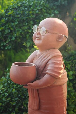 Earthenware of child monk  photo