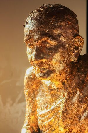 Monk statue with gold leaf  photo