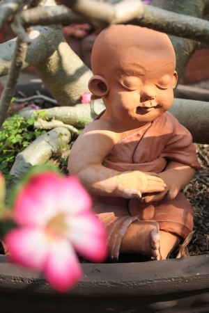 Earthenware of little Buddhist monk Stock Photo - 17156046