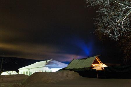 Night walk through the village. Ural Russia. 免版税图像