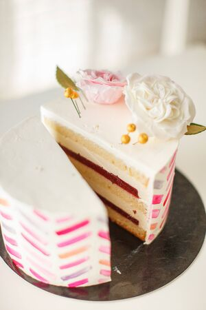 Cake with pink stripes and floral decorations
