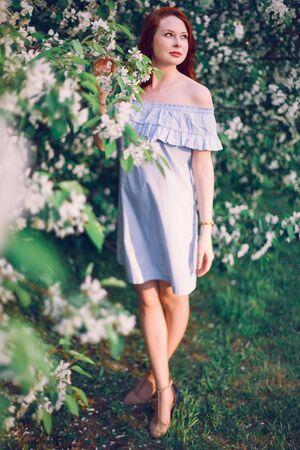 Model Olesya poses in apple blossom