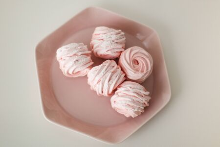 a plate of strawberry marshmallows