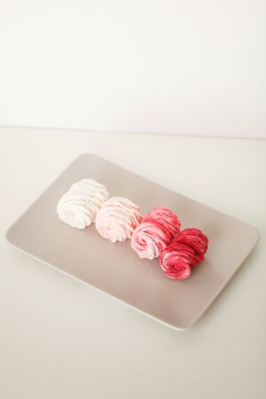 Fruit marshmallow on a gray plate 스톡 콘텐츠
