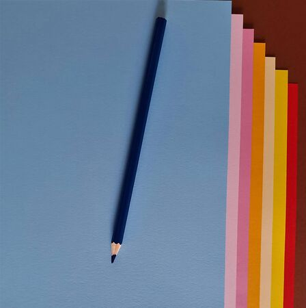 Blue pencil on colored sheets of paper, copy space Banque d'images