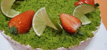 Cake with strawberries and green lemon, lime. Pastry