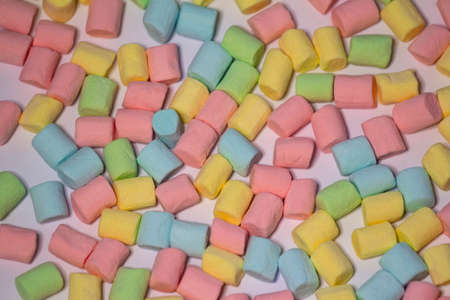 Background or texture of mini colorful marshmallows, food, copy space