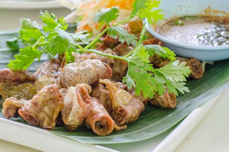chitterlings: Chitterlings Fried garlic on white back ground,