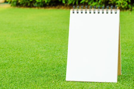 Notebook on fresh spring green grass photo